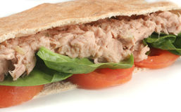 Tuna pita. Tuna with spinach and tomato in a whole wheat pita Royalty Free Stock Photos