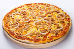 Tuna pizza 2. Pizza with tuna on the wooden plate Stock Images