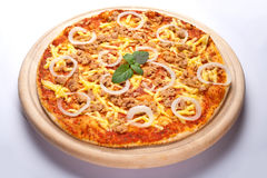 Tuna pizza. Pizza with tuna on the wooden plate Stock Image