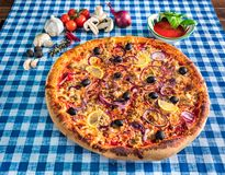 Tuna pizza with lemon and olives royalty free stock photo