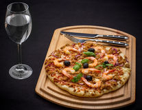 Tuna pizza with shrimp and water, cutlery Stock Photos