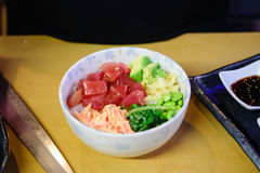 Tuna poke bowl. Japanese poke bowl with veggies and rice Royalty Free Stock Photography