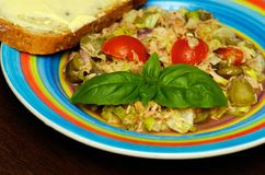 The tuna salad. Healthy food. Tuna salad on the table with bread Stock Images