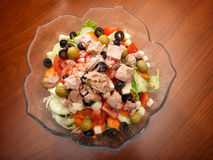 Tuna salad. Delicious tuna salad with many various vegetables in a bowl on the table Royalty Free Stock Photos