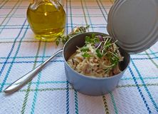 Tuna salad in a can. Tuna salad in a tuna can, and olive oil Royalty Free Stock Image