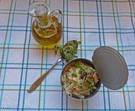 Tuna salad in a can. Tuna salad in a tuna can, and olive oil Stock Photos