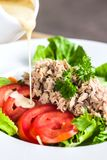 The tuna salad in dish on wood table Stock Photos