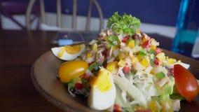 Tuna salad with egg and vegetables. Tuna salad with egg and different vegetables, tomato, onion, cabbage stock footage