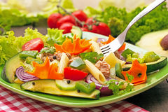 Tuna salad. Fresh healthy tuna salad with fork in the plate Royalty Free Stock Photography