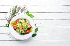 Tuna salad and fresh vegetables on a white wooden background. Free space for your text. Top view royalty free stock images
