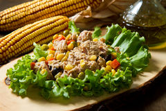 Tuna salad with mais on wood board Royalty Free Stock Image