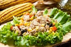 Tuna salad with mais on wood board Stock Image