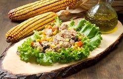 Tuna salad with mais on wood board Royalty Free Stock Photos