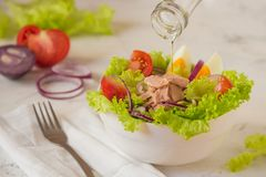 Tuna salad. Nicoise - fresh salad with canned fish and vegetable Stock Photo