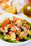 Tuna salad with pasta, green and black olives. Delicious tuna salad with pasta, tomato and olives Stock Photography