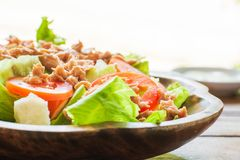 Tuna salad with red raw tomato, fresh lettuce. Hight vitamins and low fat for loose weight. Heathy food concept