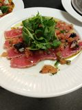 tuna salad rocket starter white stock photo