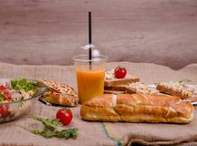 Tuna salad, sandwiches and juice on sack royalty free stock photography