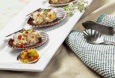 Tuna salad on scallop shells. Royalty Free Stock Photos