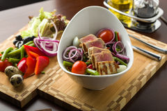 Tuna salad with ingredients. Tuna salad served on cutting board with ingredients Stock Photography