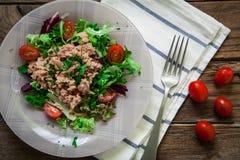 Tuna salad and tomato. Healthy tuna salad with cherry tomato and rucula Royalty Free Stock Photos