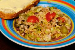 Tuna Salad with Tomatoes. And piece of buttered bread Royalty Free Stock Photos