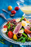 Tuna salad with tomatoes, boiled eggs, onion, anchovy and lettuc. Tuna salad & x28; Nicoise& x29; with tomatoes, boiled eggs, onion, anchovy and lettuce Royalty Free Stock Photography
