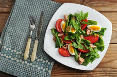 Tuna salad - tuna, spinach, egg, tomatoes, mustard Royalty Free Stock Photo