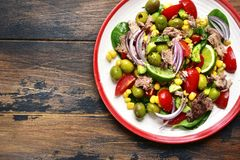 Tuna salad with vegetable and olive oil.Top view with copy space Royalty Free Stock Images