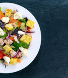 Tuna salad with vegetables on blue stone background Stock Photography