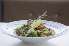 Tuna salad. With vegetables on the plate Royalty Free Stock Image