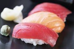 Tuna and Salmon Nigiri Rolls. Tuna ans salmon nigiri sushi rolls with ginger and wasabi stock images