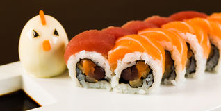 Tuna and Salmon Roll. Fancy tuna and salmon roll  on a white plate garnished with a hard boiled egg Royalty Free Stock Image