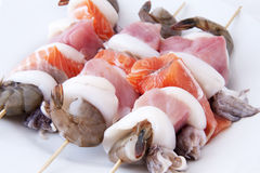 Seafood skewers Stock Images