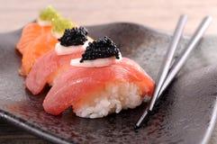 Tuna and salmon sushi set with chopsticks Royalty Free Stock Photography