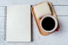 Tuna sandwich notebook and coffee red cup Royalty Free Stock Images