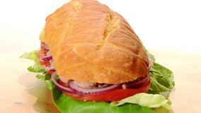 Tuna sandwich. Over white background stock video