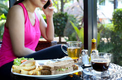 Tuna sandwich on plate and chips ,coffee , tea with woman on the Royalty Free Stock Image