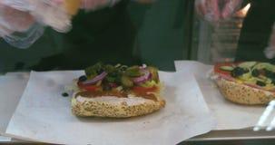 Tuna sandwich. Tuna sandwich salad preparation adding salt and black pepper stock video