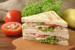 Tuna sandwich. Tuna, sandwich, tomato, vegetable, table cloth, chopping board, cucumber, breakfast, healthy, food, snack, lettuce, salad, napkins, meal royalty free stock photo