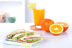 Tuna sandwiches and orange juice in the kitchen   Stock Images
