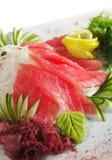 Tuna Sashimi. Sliced Raw Tuna on Daikon (White Radish) with Seaweed and Cucumber stock photography