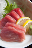 Tuna sashimi. With lemon and wasabi royalty free stock images