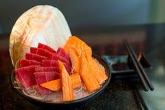 Tuna, sashimi and crab on ice in black cup,. Sushi japanese food Stock Image