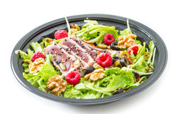 Tuna sashimi with fresh salad , raspberry and nut Royalty Free Stock Photography