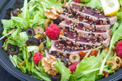 Tuna sashimi with fresh salad , raspberry and nut. Some tuna sashimi with fresh salad , raspberry and nut Stock Photo