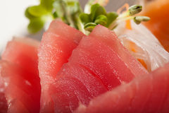 Tuna sashimi. Raw Tuna fish in traditional Japanese style eat with slice daikon radish Stock Photos