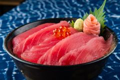 Tuna sashimi with rice. Tuna sashimi with rice and salmond roe on top or maguro don in Japanese style food stock images