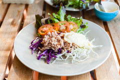 Tuna salad on wood table Royalty Free Stock Images