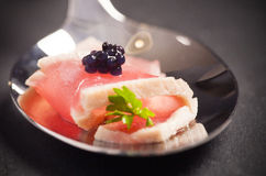 Tuna on a spoon Stock Image